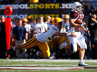 Paul Canevari #22 of Don Bosco runs past James Sheehan #59 of St Ignatius during the game at Harding Stadium in Steubenville, OH on September 25, 2010. ...Jared Wickerham.