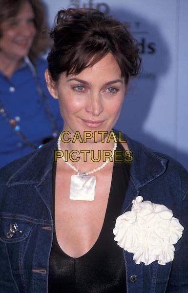 CARRIE ANNE MOSS.corsage, necklace, headshot, portrait.www.capitalpictures.com.sales@capitalpictures.com.©Capital Pictures
