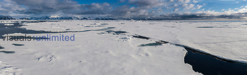 Arctic ice pack with large intact pieces and broken areas north of Spitsbergen, Svalbard, Norway.