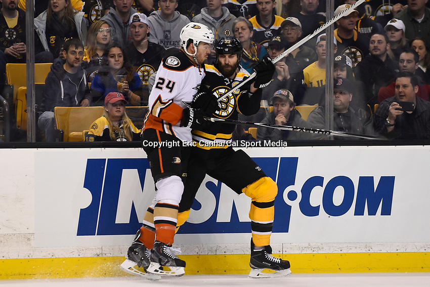 March 26, 2015 - Boston, Massachusetts, U.S. - Anaheim Ducks defenseman Simon Despres (24) and Boston Bruins defenseman Zdeno Chara (33)  battle at the boards during the first period of the NHL match between the Anaheim Ducks and the Boston Bruins held at TD Garden in Boston Massachusetts. Eric Canha/CSM