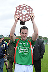 Glen Emmets captain Aidan Monaghan pictured with the Kevin Mullen shield after they beat Naomh Fionnbarra at Monasterboice. Photo: www.colinbellphotos.com