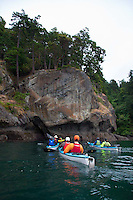 Kayaking with San Juan Outfitters in Haro Strait off Stuart Island, San Juan Islands, Washington, US