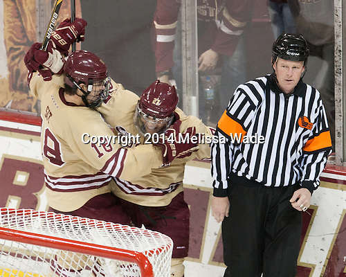 Michael Sit (BC - 18), Quinn Smith (BC - 27), Jack Millea - The Boston College Eagles defeated the visiting University of Michigan Wolverines 5-1 (EN) on Saturday, December 13, 2014, at Kelley Rink in Conte Forum in Chestnut Hill, Massachusetts.