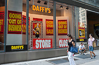 A midtown Manhattan branch of Daffy's, the bargain department store, is seen in New York on Sunday, August 12, 2012. JEMB Realty Corp. will be liquidating the 51 year old chain which is closing all of its 19 stores in the next few months. Joining other discounts chains such as Filene's Basement and Syms in discount heaven. The firm was founded by Irving Shulman in 1951 in New Jersey, originally named Daffy Dan's Bargain Town and sold off-price designer clothing.  (© Richard B. Levine)