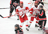 Jenn Wakefield (BU - 9), Taylor Holze (BU - 24), Dani Rylan (NU - 2) - The Boston University Terriers defeated the visiting Northeastern University Huskies 3-0 on Tuesday, December 7, 2010, at Walter Brown Arena in Boston, Massachusetts.