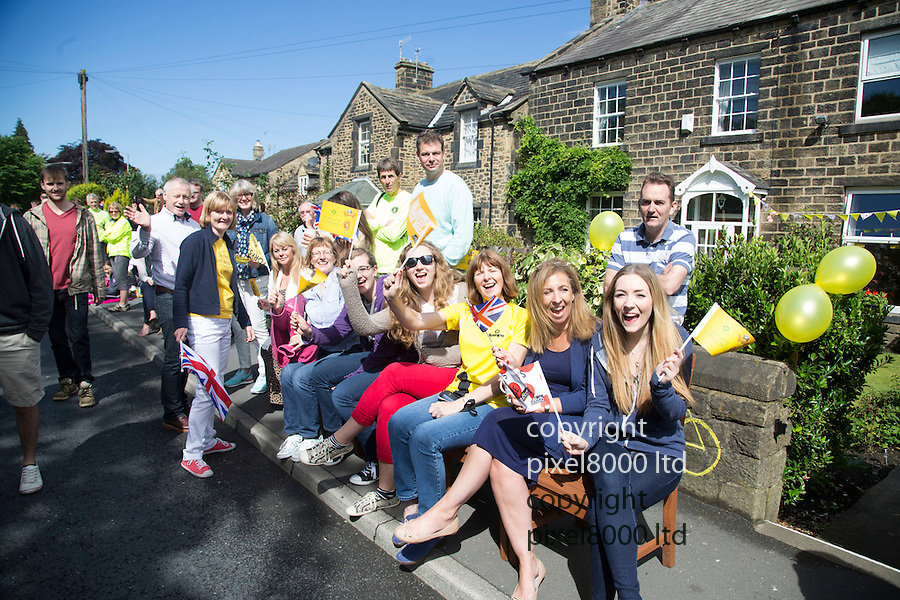 Grand Depart - Tour de France 2014<br /> Yorkshire England.<br /> Leaders go through famous town of Ilkley with Moors in distance.<br /> <br /> Fans on the street outside their home<br /> Pic by Gavin Rodgers/Pixel 8000 Ltd