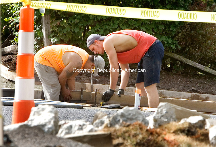 WATERBURY CT. 29 September 2015-092915SV04-From left, Mauricio Loja and Thaddaeus Vaichus work on reconstructing the sidewalks on Lincroft Drive in Waterbury Tuesday. The work is part of a city paving project. <br /> Steven Valenti Republican-American