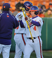 Center fielder Thomas Brittle (4) of the Clemson Tigers scores a run in the seventh inning of a game against the Wofford Terriers on Wednesday, March 6, 2013, at Doug Kingsmore Stadium in Clemson, South Carolina. Clemson won, 9-2. (Tom Priddy/Four Seam Images)