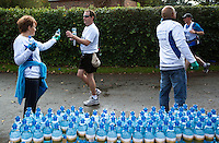 09 SEP 2011 - CHESTER, GBR - A competitor takes a bottle of water from one of the volunteers at the aid station in Churton during the MBNA Chester Marathon (PHOTO (C) NIGEL FARROW)