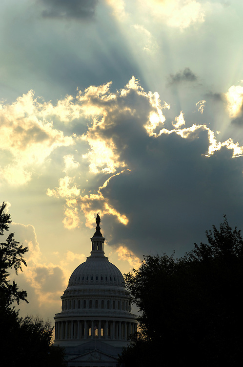 Clouds make a dramatic sunset behind the dome of the U.S. Capitol in Washington, D.C.