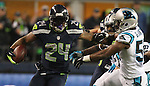 Seattle Seahawks Marshawn Lynch (24) runs through the Carolina Panthers defenders Luke Kuechly (59) Thomas Davis (58) and Adarius Glanton (57)enroute to a 25-yard gain in the NFC Western Division Playoffs at CenturyLink Field  on January 10, 2015 in Seattle, Washington. The Seahawks beat the Panthers 31-17. ©2015. Jim Bryant Photo. All Rights Reserved.