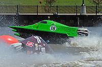 Frame 2: Jason Nelson, (#18) flips over in turn 2. (SST-45 class)