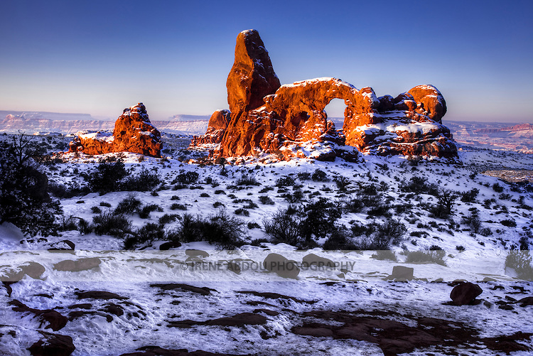 Turret Arch looms in the distance.  Fantastic rock formations and arches sculpted over thousands of years by wind, rain, and other forces of erosion dot the winter landscape of Arches National Park in southern Utah.
