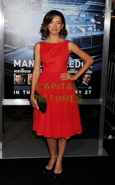 India de Beaufort.L.A. Premiere of 'Man on a Ledge' held at The Grauman's Chinese Theatre in Hollywood, California, USA..January 23rd, 2012.full length dress red sleeveless black clutch bag hand on hip.CAP/ROT/TM.©Tony Michaels/Roth Stock/Capital Pictures