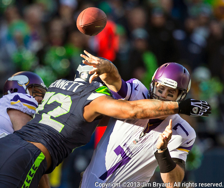 Seattle Seahawks defensive end Michael Bennett (72) pass rushes  Minnesota Vikings Christian Ponder (7) in the quarter at CenturyLink Field in Seattle, Washington on  November 17, 2013.  The Seahawks beat the Vikings 41-20.  ©2013.  Jim Bryant. All Rights Reserved.