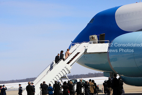 United States President Barack Obama, First Lady Michelle Obama and  Marian Robinson board Air Force One at Joint Base Andrews in Maryland en route to Maxwell Air Force Base in Alabama where they will participate in a commemoration of the 50th anniversary of the march in Selma, Alabama on March 7, 2015. The motorcade traveled to Joint Base Andrews due to a lockdown at the White House. <br /> Credit: Dennis Brack / Pool via CNP