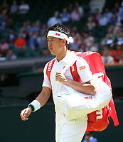 Kei Nishikori (JPN) enters the court prior to his match against Cameron Norrie (GBR) in their Gentleman's Singles Second Round match<br /> <br /> Photographer Rob Newell/CameraSport<br /> <br /> Wimbledon Lawn Tennis Championships - Day 4 - Thursday 4th July 2019 -  All England Lawn Tennis and Croquet Club - Wimbledon - London - England<br /> <br /> World Copyright © 2019 CameraSport. All rights reserved. 43 Linden Ave. Countesthorpe. Leicester. England. LE8 5PG - Tel: +44 (0) 116 277 4147 - admin@camerasport.com - www.camerasport.com
