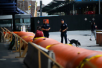 "NEW YORK, NY - AUGUST 4: NYPD officers stand guard next to water barriers used to prevent flooding at the South Street Seaport as city gets ready for tropical storm Isaias on August 4, 2020 in New York City. The Tri-State area ""New York, New Jersey and Connecticut"" is preparing for torrential rain, strong winds from Tropical storm Isaias. (Photo by Eduardo MunozAlvarez/VIEWpress)"