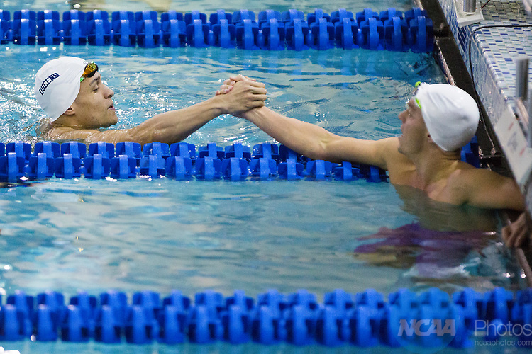 BIRMINGHAM, AL - MARCH 11: Marius Kusch of Queens University is congratulated after winning the 100 yard freestyle during the Division II Men's and Women's Swimming & Diving Championship held at the Birmingham CrossPlex on March 11, 2017 in Birmingham, Alabama. (Photo by Matt Marriott/NCAA Photos via Getty Images)
