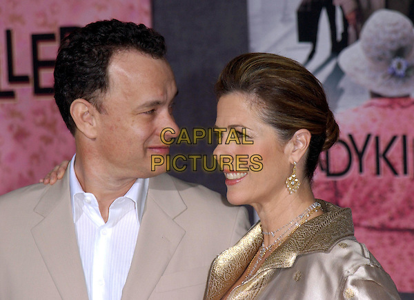 TOM HANKS & WIFE RITA WILSON.Los Angeles Premiere of The LadyKillers held at The El Capitan Theatre in Hollywood, California .12 March 2004.*UK Sales Only*.portrait, headshot .www.capitalpictures.com.sales@capitalpictures.com.©Capital Pictures.