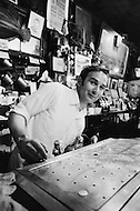 August 1970, Manhattan, New York City, New York State, USA --- The owner and manager of McSorley's Old Ale House in Manhattan bartending in 1970. McSorley's was New York City's oldest bar and refused female patrons before 1970. --- Image by © JP Laffont