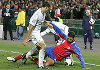 Steve Cherundolo #6 and Jose Francisco Torres #14 of the USA battle for the ball with Alvaro Saborio #9 of Costa Rica during a 2010 World Cup qualifying match in the CONCACAF region at RFK Stadium on October 14 2009, in Washington D.C.The match ended in a 2-2 tie.