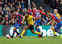7th March 2020; Selhurst Park, London, England; English Premier League Football, Crystal Palace versus Watford; Troy Deeney of Watford being challenged by James McArthur, James McCarthy and Gary Cahill of Crystal Palace