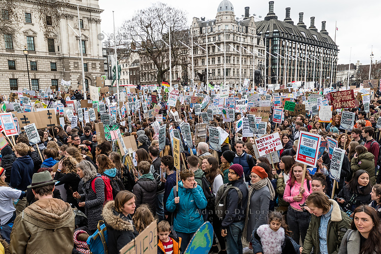 London, England on 15 March 2019: many people in westminster rise the protest sign during the youth climate strike in London. The protest against climate change and urge the government to take action.The global movement has been inspired by teenage activist Greta Thunberg, who has been skipping school every Friday since August to protest outside the Swedish parliament. Photo Adamo Di Loreto/BunaVista*photo