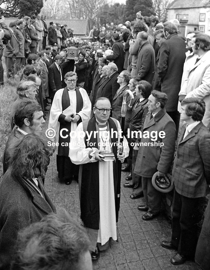 The Church of Ireland Bishop of Clogher, Dr R W Heavener, followed by the local clergyman, Rev T J Gray, head the funeral cortege of Senator Billy Fox, 35 years, Protestant, Fine Gael politician, Co Monaghan, Rep of Ireland, 14th March 1974 as it arrives Aughamullen Parish Church, Castleblaney. Fox was previously a TD (Irish MP).  He was visiting the home near Clones of his fiancee, Marjorie Coulson, which unknown to him had been taken over by thirteen armed paramilitaries. He ran from the scene but was followed and shot dead in a nearby field. Five members of the Provisional IRA were subsequently tried and convicted of the killing. 197403140164e. .Copyright Image from Victor Patterson, 54 Dorchester Park, Belfast, United Kingdom, UK...For my Terms and Conditions of Use go to http://www.victorpatterson.com/Victor_Patterson/Terms_%26_Conditions.html