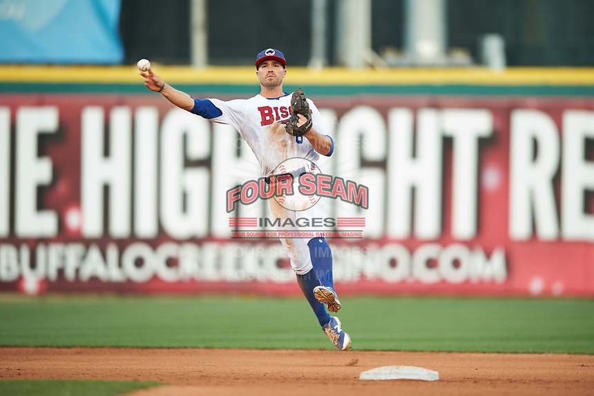 Buffalo Bisons second baseman Jon Berti (8) throws to first base for the out after making a play up the middle during a game against the Syracuse Chiefs on July 3, 2017 at Coca-Cola Field in Buffalo, New York.  Buffalo defeated Syracuse 6-2.  (Mike Janes/Four Seam Images)