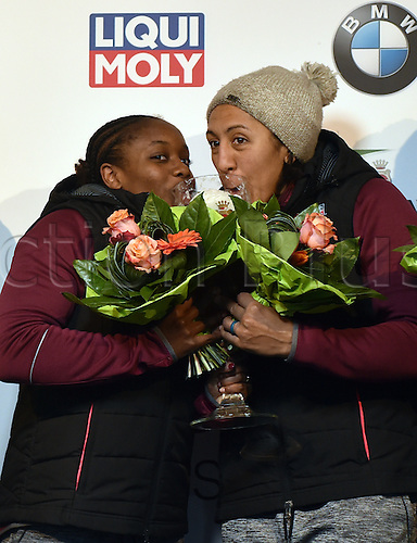 13.01.2017. Winterberg, Germany.  American bobsleighers Jamie Greubel Poser (R) and Aja Evans celebrate after taking third place at the Bobsleighing World Cup in Winterberg, Germany, 13 January 2017.