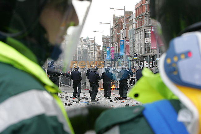 Dublin Ireland, Riots brake out on Dublin's O'Connell street as the Orange order  try to march down O'Connell street. Motorcycles and vehicles were set alight and any material that could be used was fired at the Garda (Police) as shops were looted and windows smashed..Photo AFP/NEWSFILE/FRAN CAFFREY..(Photo credit should read AFP PHOTO/FRAN CAFFREY/NEWSFILE)...This Picture has been sent you under the condtions enclosed by:.Newsfile Ltd..the Studio,.Millmount Abbey,.Drogheda,.Co Meath..Ireland..Tel: +353(0)41-9871240.Fax: +353(0)41-9871260.GSM: +353(0)86-2500958.email: pictures@newsfile.ie.www.newsfile.ie.FTP: 193.120.102.198..This picture is from Fran Caffrey@newsfile.ie