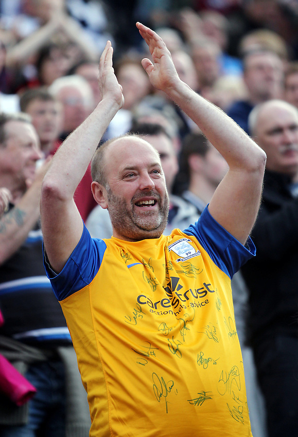 Preston North End fans applaud their team at the end of the match<br /> <br /> Photo by Rich Linley/CameraSport<br /> <br /> Football - The Football League Sky Bet League One - Preston v Gillingham - Saturday 26th April 2014 - Deepdale - Preston<br /> <br /> &copy; CameraSport - 43 Linden Ave. Countesthorpe. Leicester. England. LE8 5PG - Tel: +44 (0) 116 277 4147 - admin@camerasport.com - www.camerasport.com