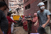 People is helping for relief near collapsed houses following the earthquake in Bhaktapur, near Kathmandu, Nepal. May 7, 2015