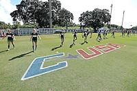 8 November 2015:  Marshall's team warms up near the Conference USA logo painted on the field prior to the match as the University of North Texas Mean Green defeated the Marshall University Thundering Herd, 1-0, in the Conference USA championship game at University Park Stadium in Miami, Florida.