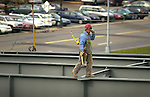 Market Street Bridge construction, Williamsport, PA. Secured worker walking on new beam.