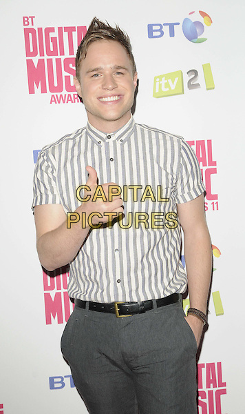 Olly Murs.BT Digital Music Awards held at the Roundhouse, Chalk Farm, London, England..September 29th 2011.half length grey gray white shirt hand in pocket trousers thumb up.CAP/CAN.©Can Nguyen/Capital Pictures.