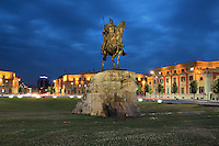 Bronze equestrian statue of George Kastrioti Skanderbeg, a 15th century Albanian nobleman, in the centre of Skanderbeg Square or Sheshi Skenderbej in Tirana, Albania. The statue is by Odhise Paskali, Andrea Mano and Janaq Paco and was inaugurated in 1968, on the 500th anniversary of his death. Tirana was founded by the Ottomans in 1614 by Sulejman Bargjini and became the capital of Albania in 1920. Picture by Manuel Cohen