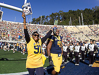 Deandre Coleman watches his mom Deborah Coleman waving to the fans during Senior Day before NCAA football game against USC at Memorial Stadium in Berkeley, California on November 9th, 2013.   USC defeated California, 62-28.