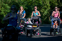 From left, Stevie Fouts, Scottsdale, Tashina with Emma age 3 and Norah age 1, Phoenix, Amanda Merrit with Hudson age 2, Phoenix, run between workout stations in a Fit4Mom class at the Phoenix Zoo.