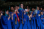 Students offer their student speaker, Brook Lynn Leonhardt, a standing ovation following her addresses to fellow classmates Sunday, June 11, 2017, during the DePaul University College of Science and Health and College of Liberal Arts and Social Sciences commencement ceremony at the Allstate Arena in Rosemont, IL. (DePaul University/Jamie Moncrief)