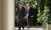 Washington, D.C. - September 3, 2005 -- United States President George W. Bush,  followed by Secretary of the United States Department of Homeland Security Michael Chertoff,  United States Secretary of Defense Donald Rumsfeld and Chairman of the Joint Chiefs of Staff General Richard Myers, United States Air Force, walk down the colonade of the White House before President Bush's radio address on September 3, 2005. <br /> Credit: Dennis Brack - Pool via CNP
