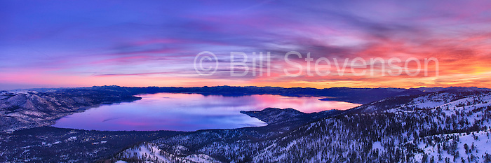 A panorama photo of  Lake Tahoe in winter at sunset. This image was taken from the mountain ridgetop above Incline Village.