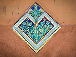 Mosaic details along Fondamenta dei Vetrai on the main canal of Murano, Italy