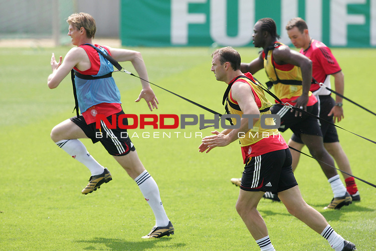 FIFA WM 2006 - Training - Germany<br /> Tim Borowski, Jens Nowotny and Gerald Asamoah (l-r) during a training session at the World Cup in Berlin (Stadion Wurfplatz). <br /> Foto &copy; nordphoto