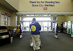 Wal-Mart greeter Clarence Hatfield, of Circleville, waits for customers at the main entrance Thursday, March 2, 2006, in Grove City, Ohio.<br />
