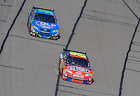 Sept. 28, 2008; Kansas City, KS, USA; Nascar Sprint Cup Series driver Jeff Gordon leads Joey Logano during the Camping World RV 400 at Kansas Speedway. Mandatory Credit: Mark J. Rebilas-