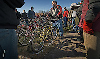 An auctioneer solicits bids for bicyles from people gathered at a police seized goods auction in Blendon Township, Ohio<br />