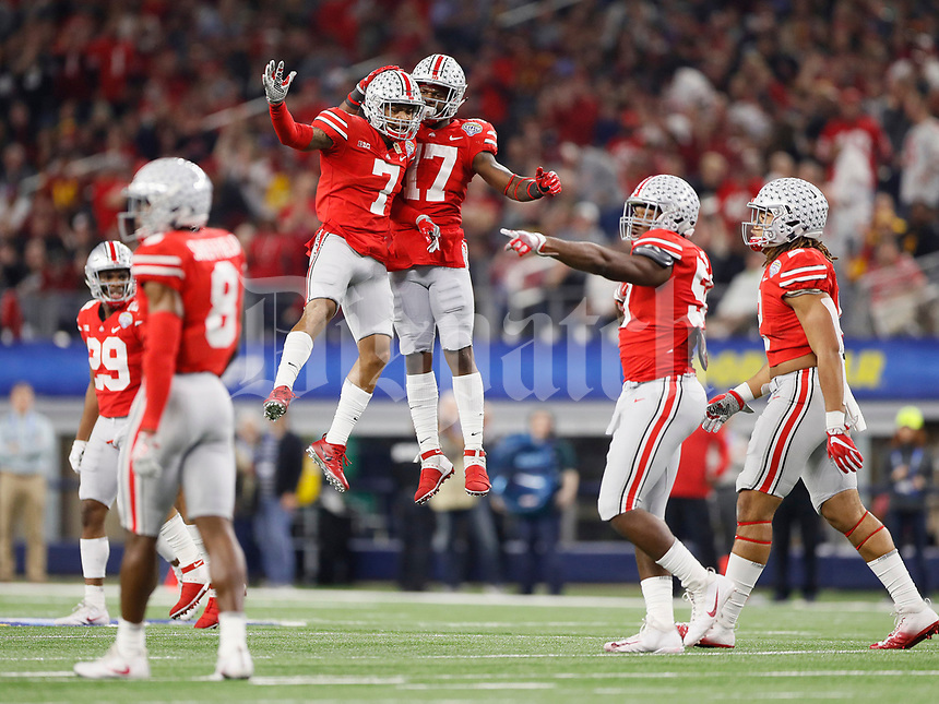 Ohio State Buckeyes safety Damon Webb (7) celebrates a fumble recovery by linebacker Jerome Baker (17) during the second quarter of the Goodyear Cotton Bowl Classic at AT&T Stadium in Arlington, Texas on Dec. 29, 2017. [Adam Cairns / Dispatch]