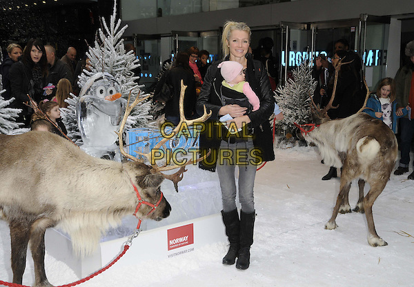 LONDON, ENGLAND - NOVEMBER 17: Nell McAndrew &amp; her baby daughter Anya at the &quot;Frozen&quot; VIP film screening, Odeon Leicester Square cinema on November 17, 2013 in London, England, UK.<br /> CAP/CAN<br /> &copy;Can Nguyen/Capital Pictures